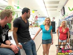 Blonde babe with fake tits in a foursome with horny dudes.