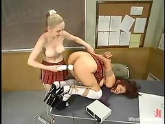 Two busty college girls enjoy playing BDSM games in a classroom