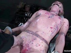 Ami Emerson toys her cunt to orgasm in a hot BDSM scene