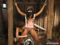 Slutty ebony honey is sitting on that fucking machine with her hair tugged