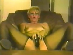 Mature blonde smashes her snatch with a big dildo in homemade scene