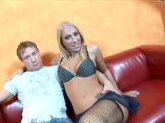 Dionne Darling the blonde in fishnets fucks on a sofa
