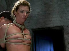 Lusty chick gets tied up and fucked with a strapon