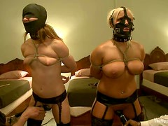 Tied up and gagged girls get whipped and toyed in a motel room