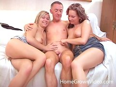 Two busty hotties drive a guy crazy with a passionate blowjob