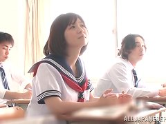 Japanese college girl gives a blowjob to a classmate.