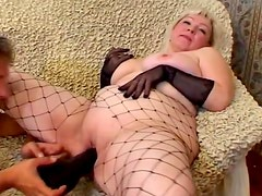 Mature blonde Cynthia sucks a cock and lets the guy toy her meaty cunt