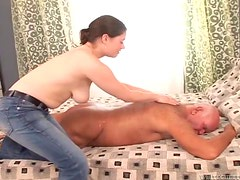 Busty chick gives a massage to old dude and rides his cock
