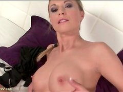 Milf has a pair of sexy and firm fake titties