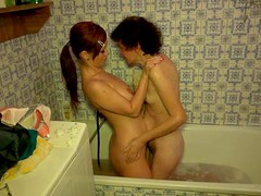 Skinny lesbian granny takes shower with her hot young girlfriend