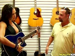 Busty Claudia Valentine buys a guitar and fucks the salesman