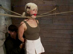 Kelly Surfer gets gagged, choked and toyed in BDSM video