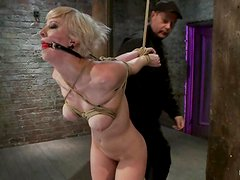 Cherry Torn gets her cunt rubbed with a dildo in BDSM scene
