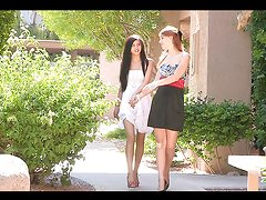 Naughty babes play with one another outdoors