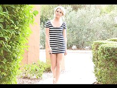 Blonde takes off her dress and shows her body in public