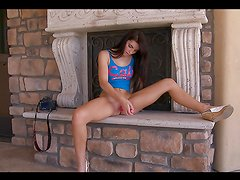 Horny teen brunette masturbates with a dildo