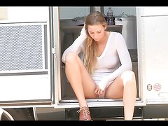Gorgeous blonde teen masturates inside a mobile home