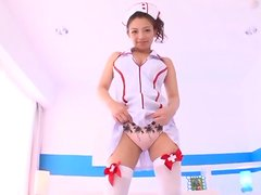 Teen with natural tits gives a handjob in her nurse costume.