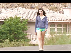 Teen brunette plays with herself outdoors