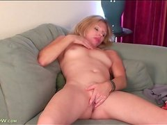 Milf Holly Jones rubs her tits and pussy