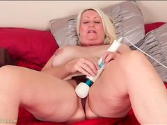 Mature with nipple rings strips and masturbates