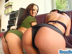 Katerina and Queenie share a cock in the yard and swap the jizz