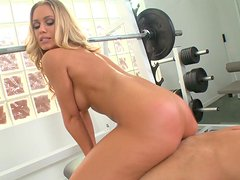 A beautiful blonde MILF gets pounded in a gym