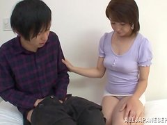 Japanese cougar seduces a young guy and gives him a blowjob