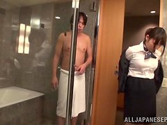 An Asian girl in an office outfit has a wild sex in a motel