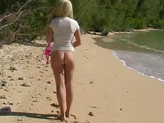 Curvy sex doll Alison Angel is posing naked on the beach