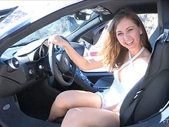 Beautiful Riley fingers her hot pussy sitting in a car