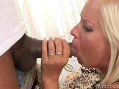 A blonde girl with tan lines gets fucked in an interracial video