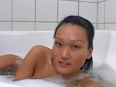 Tanned Asian Vanessa is poking her puss