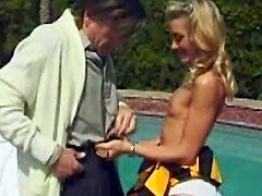 Attractive blonde cheerleader gets rammed by the pool