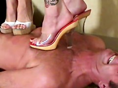 Two girls in heels trample him