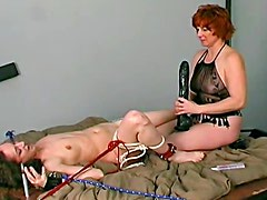 Dominant couple ties up a pretty girl