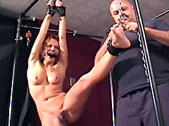 Cutie chained, gagged and drilled with a vibrator