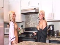 Two sizzling blondes toy their pussies and ride a dick in a kitchen