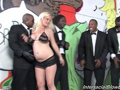 Chubby Amber Rayne gets a bukkake in interracial group blowjob scene