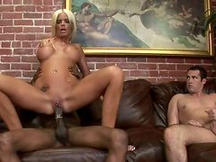 Black cock fucks the family pair in their living room.