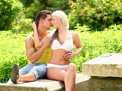 A stunning blonde babe has a passionate sex in a garden