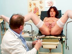 Watch a naughty mature's hairy vag