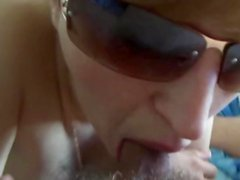Sweet amateur in glasses is sucking a cock