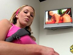 A sweet Nikki Sexx watches porn in a gloryhole room