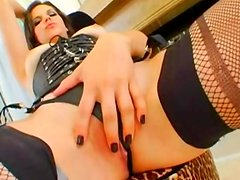 Sexy brunette is sucking her hand