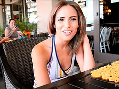 Beautiful Natasha talks on camera in a restaurant