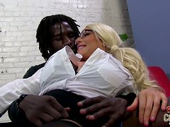 A busty MILF in glasses gets ass fucked by a Black guy