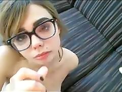 Cute babe with glasses gives BJ