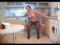 Mature chick blowing and fucking in kitchen