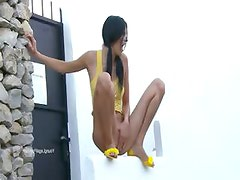Sexy woman peeing from the wall